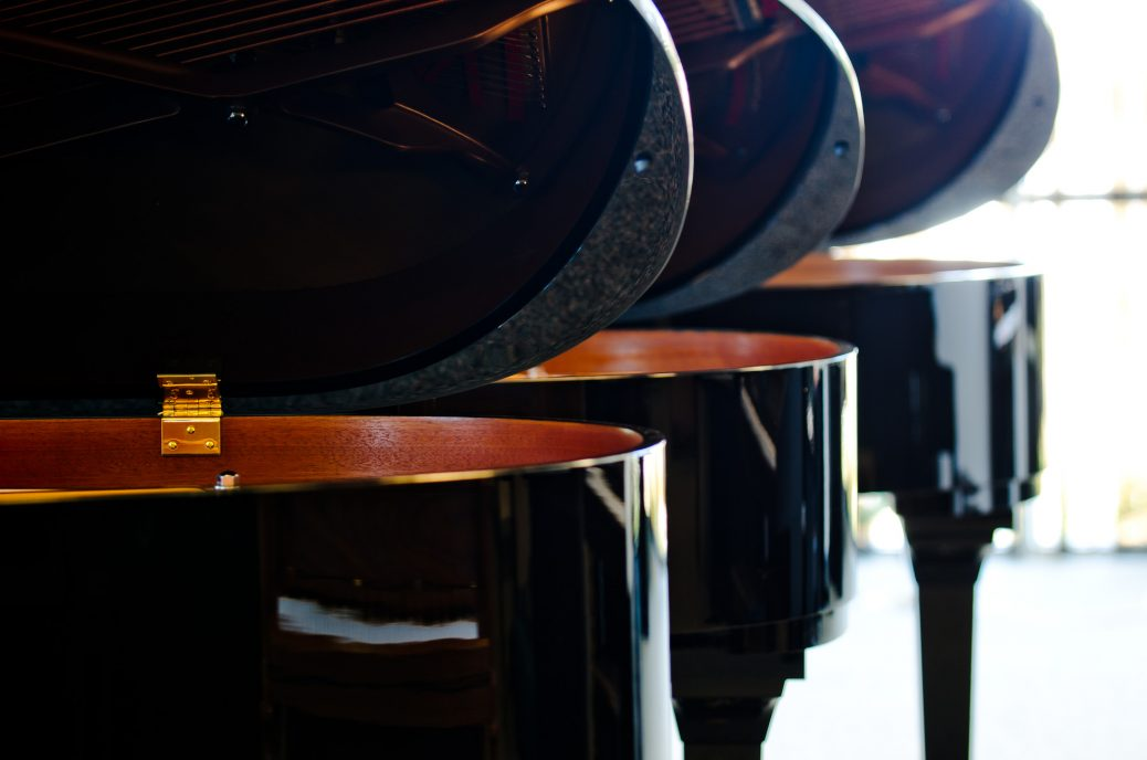 Close up photo of grand pianos | Ogden Piano Gallery