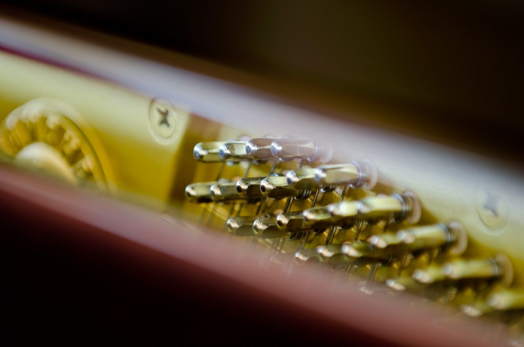 Close Up of Tuning a Piano at Ogden Piano Gallery