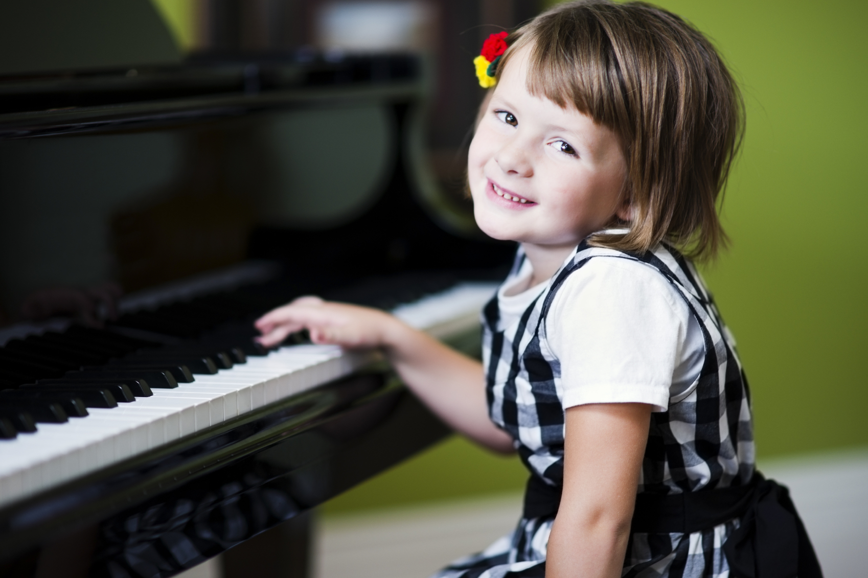 Young Girl Learning Piano
